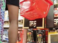 Sexy milf shopper in black pantyhose