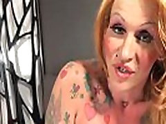 Tattooed mature trans babe jerks her cock