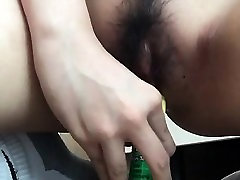 Hairy pussy toyed with dildo
