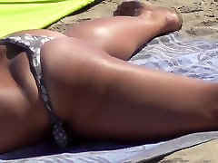 Topless Milf opens her legs and ass on beach.mp4