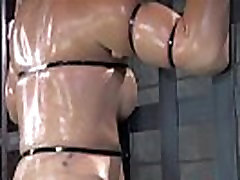 Busty restrained sub gets whipped in bdsm