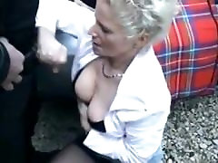 German Mature fucks 2 in forest
