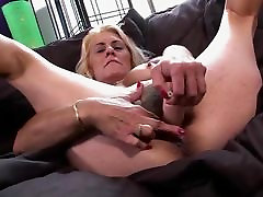 HAIRY GRANNY SHOWS OFF HER WET PUSSY