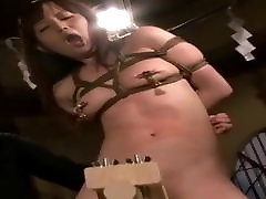 A Japanese nude lady riding on a wooden rocking horse