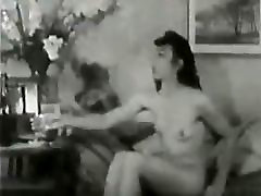 Vintage hairy lady play with bottle.
