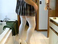 Wank and cum in garters, stockings and very short skirt....