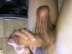 Stroking Cock with heavy hangers
