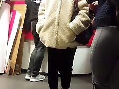 Hot teen in grey leegins waiting in line