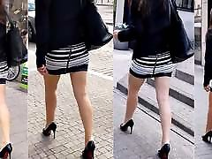 87 Woman with sexy legs in mini skirt and high heels