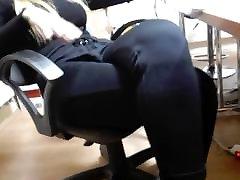 Office secretary young wife in black suit open legs