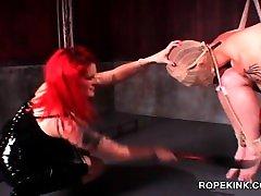 Slutty BDSM mistress using her male sex slave for torture