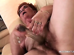 Excited mature BBW pleasing herself with a big dildo