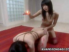 Luscious Asian babe in a kinky bondage flick