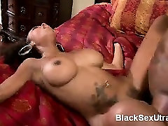 Lacey Duvalle is a girl that no guy could ever resist. Shes a beautiful black pornstar with big tits and a sexy phat ass that we just cant help but admire as she bares her clothes and joins a black guy in bed for a session of wham bam hardcore sex.