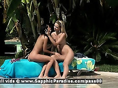 Aneta and Debby blonde and brunette lesbian babes kissing in the garden