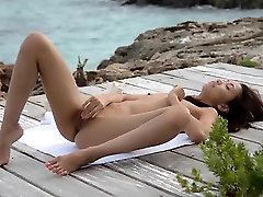 Asian angel tease by the ocean