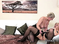 Lesbians in stockings bang with strapon dildo