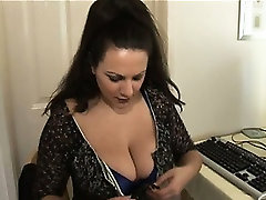 Busty mature brunette secretary in pantyhose