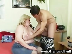 Granny getting his cock hard with mouth and tits