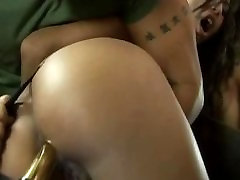 A dildo is used to fuck this big tit brunette milf