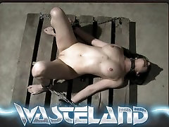 Wasteland BDSM Sex Master Ties sex slave upside down and plays with pussy