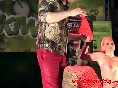Erotic magic trick on stage featuring Daniela Evans by Viciosillos.com