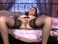 Bigtit milf in stockings rubs her mature pussy