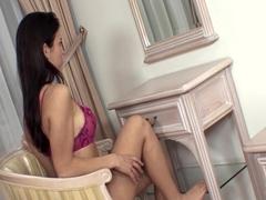 Lingerie clad brunette shows off her panties before masturbating