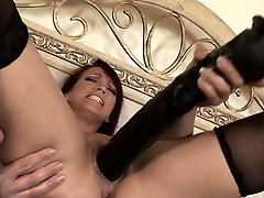 Mature babe toying her pussy with huge dildos