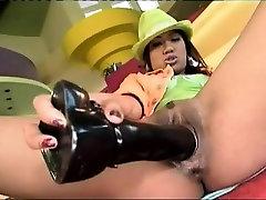 Asian babe rides a massive schlong