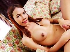 Busty Asian ladyboy Kitty T masturbating her big shecock