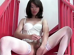 Solo lingerie ladyboy wanks on the staircase