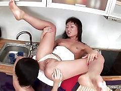 Lesbian Russians lick each other in the kitchen
