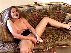 Girl with hot tits opens her pussy lips and rubs her fingers deep inside