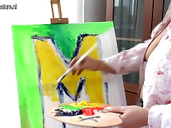 Creative mother getting naughty during painting