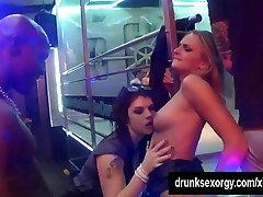 Bisexual sluts lick pussies in a club
