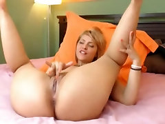 Horny blonde fills her pussy with a dildo